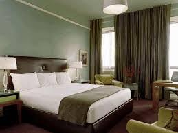 olive green comfy sofa dark brown leather bed frame plain white