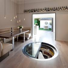 white spiral cellar with retractable round glass trap door for