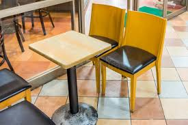 Coffe Shop Chairs Wooden Table And Chairs In A Coffee Shop Stock Image Image 70023431
