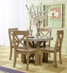 boulder ridge round concrete dining table with four slipcovered