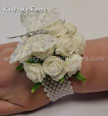 keepsake range white and butterfly wrist corsage design