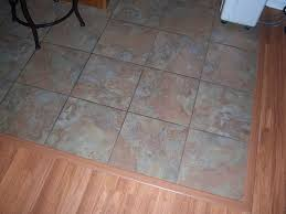 fancy grouted vinyl tile kitchen floor featuring forest ground