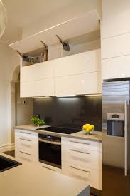 modern galley style kitchen lift up overhead cupboards by blum