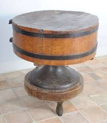 a very rare round wooden butchers block with wrought iron straps a very rare round wooden butchers block with wrought iron straps 2