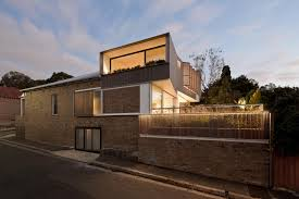 exteriors serene house design with louvered windows and brick