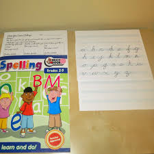 montessori writing paper expedition montessori cursive spelling fractions oh my on the left i left out the metal inset paper and pencils because we are still using these for fraction work below them dictionary research cards