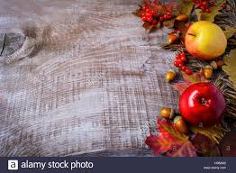 thanksgiving background image border of apples berries and fall leaves on the rustic wooden