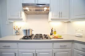 installing subway tile backsplash elegant white kitchen with