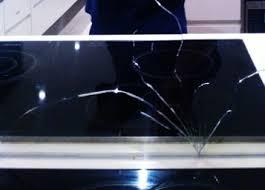 broken mirror splashback caused by cooktop valiant glass