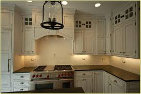 stone backsplash ideas kitchens pot filler tumbled linear stone