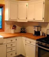 Adding Beadboard To Kitchen Cabinets by Add Trim To The Front Of Kitchen Cabinet Doors To Give More