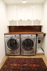 table over washer and dryer laundry room countertop over washer and dryer plywood hickory wooden