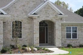 exterior halquist stone front houses with dutch door and 2 pilars