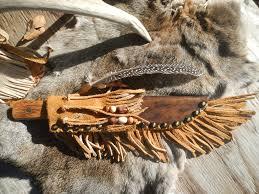 an old mountain man style custom leather knife sheath for