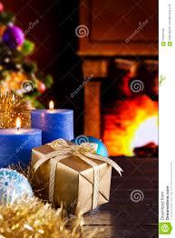 christmas scene with fireplace and christmas tree stock photo