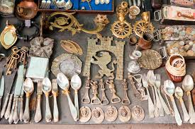 various things for sale on a flea market editorial photography