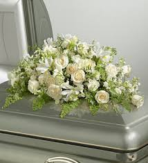funeral arrangement all white casket spray funeral arrangement amar flowers