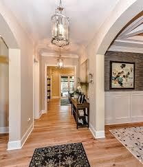 providence model home entryway light hardwood floors and chrome