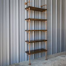 industrial shelving can be chic and with the copper finish work