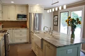 Kitchen With Glass Tile Backsplash This Kitchen Features Brown Fantasy Leathered Quartzite
