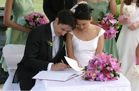 wedding signing file and groom signing the book jpg wikimedia commons