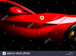 Ferrari F12 Black - ferrari f12 in red side shot of vent mirrors and logo on a black
