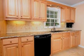 Kitchens With White Cabinets And Black Appliances by Kitchens Remodeled With Oak Cabinets And Light Counters Also