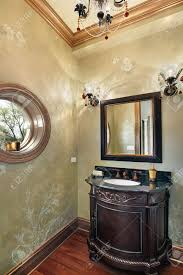 powder room in luxury home with rounded window stock photo