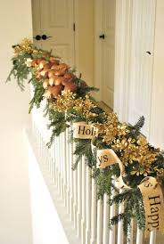 looking staircase decorating ideas with green garland