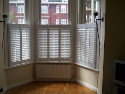 delighful plantation shutters bay window cafe style in a with seat