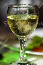 vermouth color glass of white wine or vermouth and ice picture proper for menu
