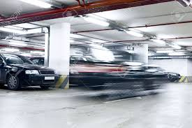 the shined underground garage with the moving cars and parked the shined underground garage with the moving cars and parked cars stock photo 4868301