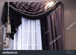 swag curtains tassles on window sheers stock photo 1052451