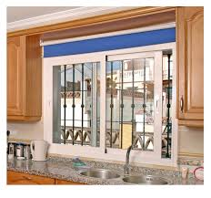 window kitchen cabinet with window designs and tile backsplash