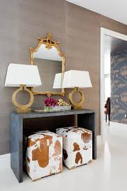 White Foyer Table Fantastic Foyer Entry Boasts A Pair Of Brown Cowhide Cube Stools