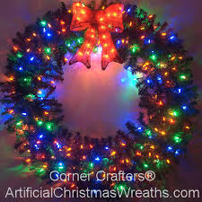 plain design wreaths with lights outdoor happy holidays