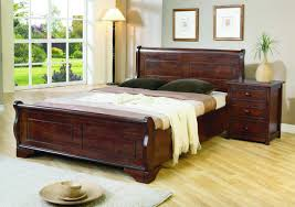 rustic dark brown wooden bed frame with head board also brown