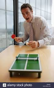 Office Desk Games by Businessman Playing Miniature Toy Table Tennis On Office Desk