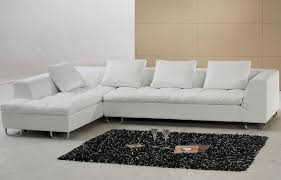 trendy white faux leather sofa with l shape also tufted cushions