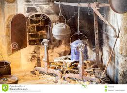 vintage kitchen fireplace and kitchen utensils stock photo