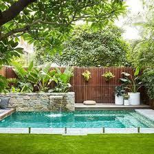small backyard pool swimming pool beautiful pools pinterest timber fencing stone
