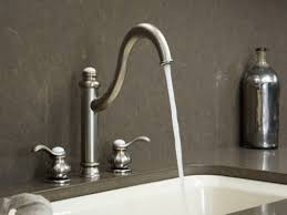 interior bronze kohler kitchen faucets on white modern kitchen