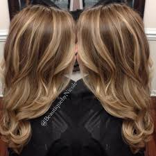 balayage on long hair blonde highlights with curled hairstyle