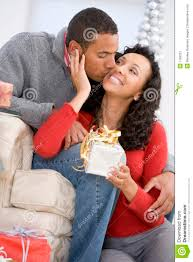husband and wife exchanging christmas gifts stock image image