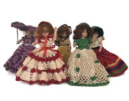 vintage dolls with crochet dresses plastic dolls articulated limbs