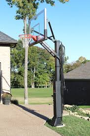 Backyard Sport Court Cost by This Is A Forest Green And Red Concrete Backyard Basketball Court