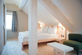 double brown wooden bed frame low ceiling attic bedroom ideas free