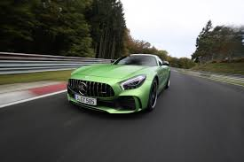 green mercedes mercedes amg gt r sets new sports car record at the nürburgring evo