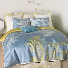 simple small bedroom design with light yellow blue twin comforter