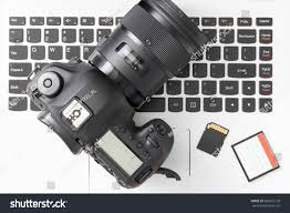 photography and videography modern digital dslr computer workstation stock photo
